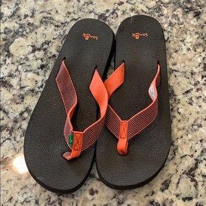 Sanuk flip flops.